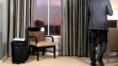 stock-footage-businessman-picks-up-cell-phone-ringing-in-hotel-room-hd