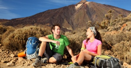 Couple Backpacking Mountain Travelling